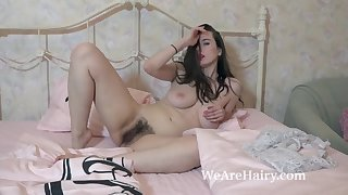 marika di has fun being naked and hairy in bed